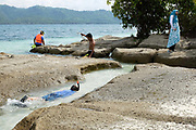 Tourists snorkelling in the sea at Gili Kedis, a small island off the coast of Lombok, Indonesea