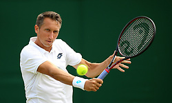 Sergiy Stakhovsky in action on day three of the Wimbledon Championships at the All England Lawn Tennis and Croquet Club, Wimbledon.