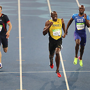 Athletics - Olympics: Day 13   Usain Bolt of Jamaica winning the gold medal in the Men's 200m Final with Christophe Lemaitre, (left), of France winning the bronze medal at the Olympic Stadium on August 18, 2016 in Rio de Janeiro, Brazil. (Photo by Tim Clayton/Corbis via Getty Images)