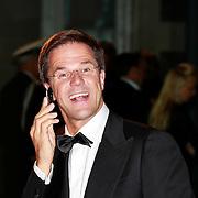 NLD/Amsterdam/20110527 - 40ste verjaardag Prinses Maxima, Premier Mark Rutte aan het bellen