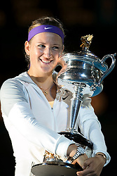 © Licensed to London News Pictures. 26/01/2013. Melbourne Park, Australia. Victoria Azarenka hugs her winners trophy while smiling  during the Womens Final between Victoria Azarenka and Li Na of the Australian Open. Photo credit : Asanka Brendon Ratnayake/LNP