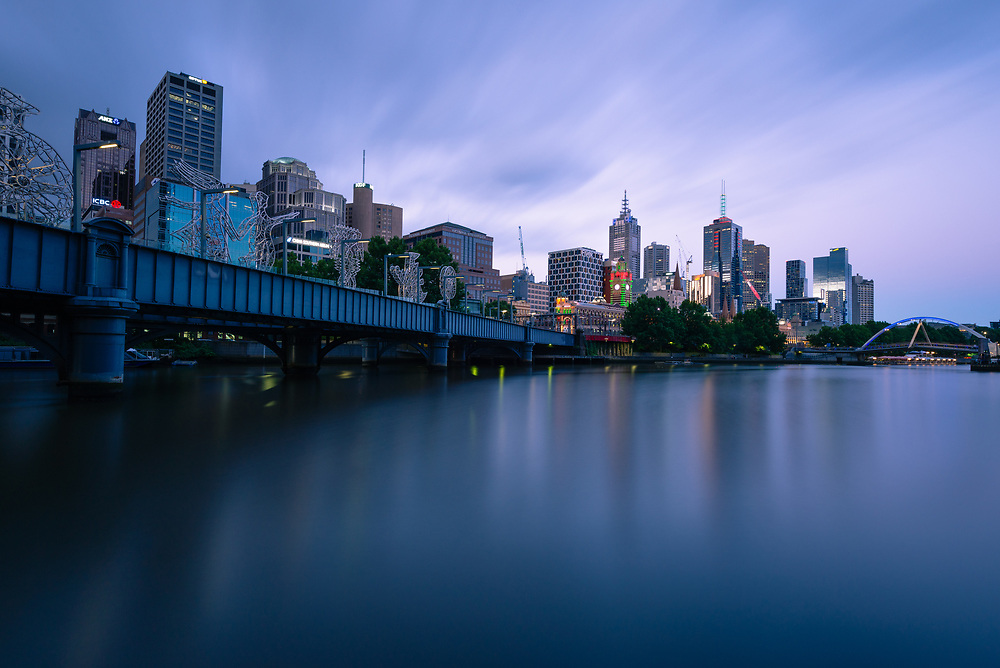 Queens Bridge and Melbourne skyline along the Yarra River