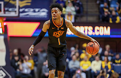 Jan 12, 2019; Morgantown, WV, USA; Oklahoma State Cowboys guard Curtis Jones (1) dribbles the ball during the first half against the West Virginia Mountaineers at WVU Coliseum. Mandatory Credit: Ben Queen-USA TODAY Sports