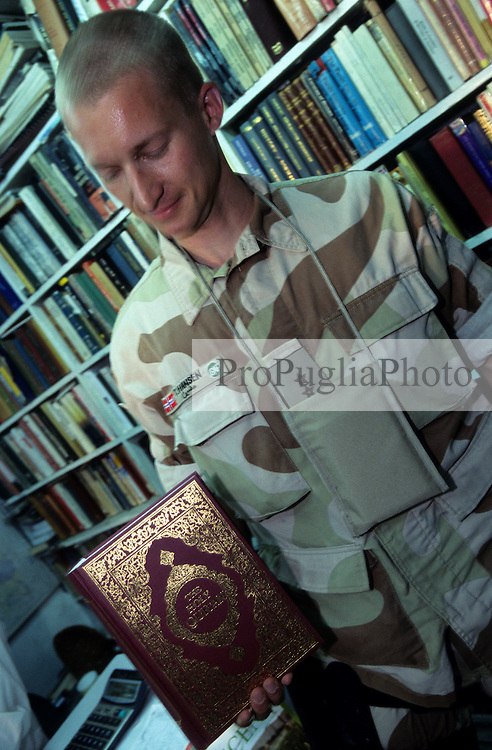 Kabul,  Shahm Book Co. 14 August 2005...T. Hansen, Danish ISAF, buys a copy of the Holy Qur'an...According to Muhammad Rias, the shop-owner, the Danish buy the Qur'an most.