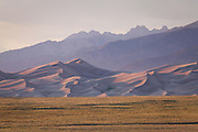 The Great Sand Dunes at sunset with the Sangre de Cristo Mountains in the distance. Great Sand Dunes National Park and Preserve, Colorado