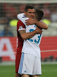 Liverpool's Dejan Lovren (left) hugs Real Madrid's Mateo Kovacic (right) after the final whistle
