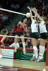 06 November 2004....Sabrina Apker and Tessa Baugh block the kill attempt of Savannah Knowles.....Illinois State University Redbirds V SouthWest Missouri State University Bears Volleyball.  Redbird Arena, Illinois State University, Normal IL..Illinois State Redbirds v Southwest Missouri State