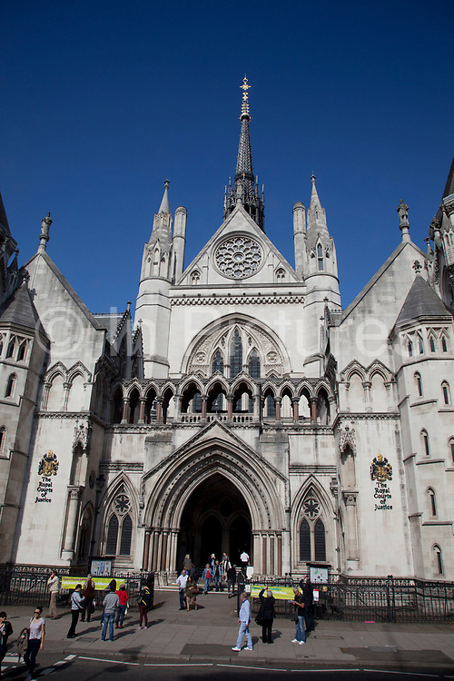The Royal Courts of Justice, commonly called the Law Courts, is the building in London which houses the Court of Appeal of England and Wales and the High Court of Justice of England and Wales. The building is a large grey stone edifice in the Victorian Gothic style and was designed by George Edmund Street, a solicitor turned architect. It was built in the 1870s.