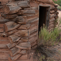 A mud-roofed log cabin lies abandoned at Ghost Ranch, near Abiquiu, New Mexico.
