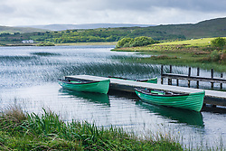 Green boats on Moher Lough, Westport, County Mayo, Ireland