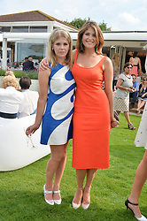 Left to right, sisters HANNAH ARTERTON and GEMMA ARTERTON at the Audi International Polo at Guards Polo Club, Windsor Great Park, Egham, Surrey on 26th July 2014.