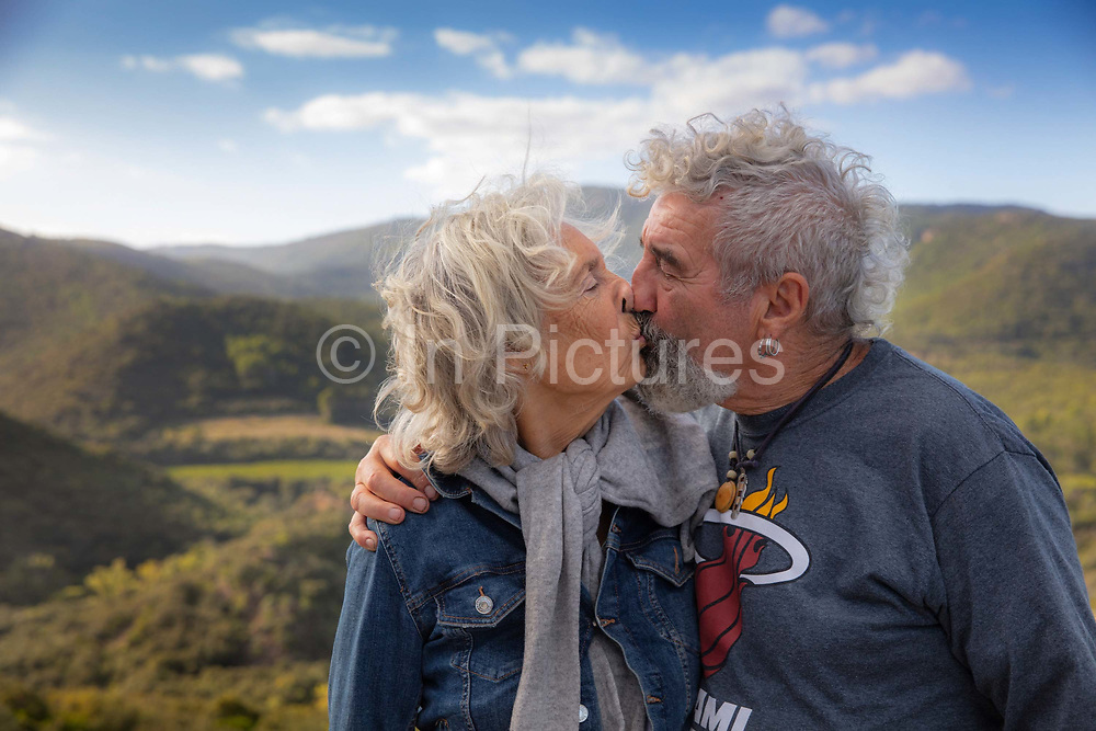 Older couple kissing in the French countryside 5th October 2019 in the village of Terme, France.