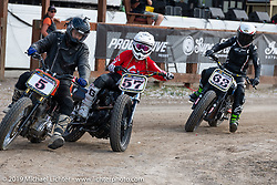 Model and Hooligan flattracker (no. 57) Stephanie Pietz om the mix for the Hooligan races on the temporary track in front of the Sturgis Buffalo Chip main stage during the Sturgis Black Hills Motorcycle Rally. SD, USA. Wednesday, August 7, 2019. Photography ©2019 Michael Lichter.