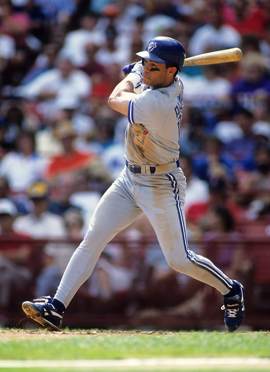MILWAUKEE - CIRCA 1990's:  Roberto Alomar of the Toronto Blue Jays bats against the Milwaukee Brewers at County Stadium in Milwaukee, Wisconsin.  Alomar played for the Blue Jays from 1991-1995.  (Photo by Ron Vesely)