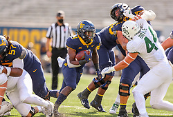 Oct 3, 2020; Morgantown, West Virginia, USA; West Virginia Mountaineers running back Leddie Brown (4) runs the ball during the third quarter against the Baylor Bears at Mountaineer Field at Milan Puskar Stadium. Mandatory Credit: Ben Queen-USA TODAY Sports