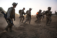 Marines trudge through dirt after live-fire exercises for the 2nd Battalion, 5th Marine Regiment at Camp Pendleton.
