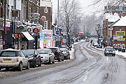 Kings Heath Hih Street in the snow on 24th January 2021 in Birmingham, United Kingdom. Deep snow arrived in the Midlands giving some light relief and fun during the current lockdown for people who simply enjoyed the weather.