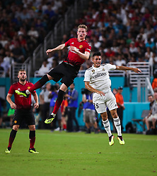 July 31, 2018 - Miami Gardens, Florida, USA - Manchester United F.C. midfielder Scott McTominay (39) follows the ball in midair, after a header over Real Madrid C.F. midfielder Oscar Rodriguez (35), during an International Champions Cup match between Real Madrid C.F. and Manchester United F.C. at the Hard Rock Stadium in Miami Gardens, Florida. Manchester United F.C. won the game 2-1. (Credit Image: © Mario Houben via ZUMA Wire)