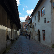 Historic street Katarina Kirik with medieval tomb stones in Tallinn old town district