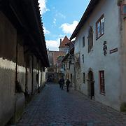 Historic street Katarina Kirik with medieval tomb stones in Tallinn old town district