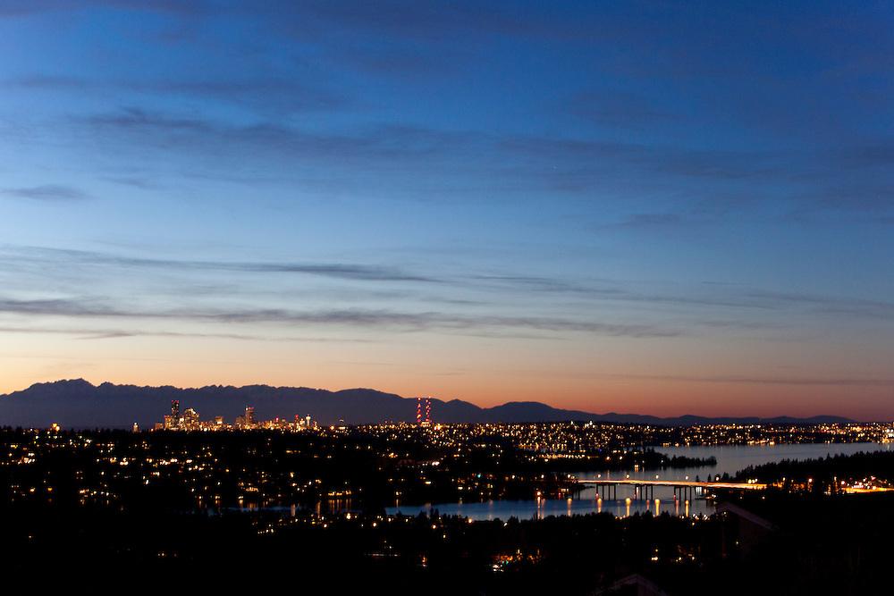 North America, United States, Washington, Seattle, Lake Washington, I90 bridge, downtown skyline and Olympic Mountains viewed from Bellevue at sunset