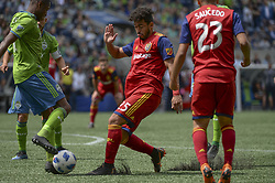 May 26, 2018 - Seattle, Washington, U.S - MLS Soccer 2018: RSL's DANILO ACOSTA (25) pushes the ball up the field against the Seattle defense as Real Salt Lake visits the Seattle Sounders in a MLS match at Century Link Field in Seattle, WA. (Credit Image: © Jeff Halstead via ZUMA Wire)