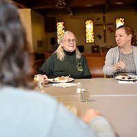 Betsy Windisch, left, and Marcia Monterroso, right, discuss one of the volunteer opportunities that they look to plan for this summer. The meeting at the Westminster Presbyterian Church on Tuesday.