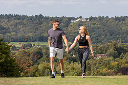 """© Licensed to London News Pictures. 11/09/2020. Surrey, UK. Walkers enjoy glorious views and hazy sunshine before the """"Rule of 6"""" comes in to force on Monday from Box Hill in Surrey this afternoon as weather experts announce a 7 day mini-heatwave to hit England this week with highs in excess of 28c. Photo credit: Alex Lentati/LNP"""