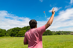 Taking advantage of the bank holiday Sunday sunshine and breeze, IT consultant Arunabh Ankur, 36, flies his kite on Parliament Hill in North London. London, May 26 2019.