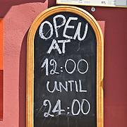 Restaurant board with open hours of restaurant