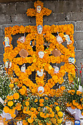 An ofrenda or altar made from marigolds decorates a tomb at cemetery during the Day of the Dead festival November 2, 2017 in Ihuatzio, Michoacan, Mexico.  The festival has been celebrated since the Aztec empire celebrates ancestors and deceased loved ones.