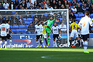 Bolton Wanderers' Goalkeeper Andy Lonergan punches clear. Skybet football league championship match, Bolton Wanderers v Brentford at the Macron stadium in Bolton, Lancs on Saturday 25th October 2014.<br /> pic by Chris Stading, Andrew Orchard sports photography.