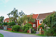 The red houses on the road in Bullerbyn Mellangården, The Middle House. Sörgården, The South House. Norrgården, The North House. The original location where Astrid Lindgren's story on Bullerbyn was filmed. In reality called Sevedstorp. Smaland region. Sweden, Europe.