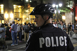 CHARLOTTE, Sept. 23, 2016 (Xinhua) -- A police officer stands guard as people take part in a protest in Charlotte, North Carolina, the United States, Sept. 22, 2016. A curfew order was issued in the U.S. city of Charlotte Thursday night as hundreds of protesters marched relatively peacefully through downtown to protest the fatal police shooting of a black man for the third night.  (Xinhua/Lu Jiafei)(zcc) (Credit Image: © Lu Jiafei/Xinhua via ZUMA Wire)