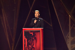 EDITORIAL USE ONLY.<br /><br />Gary Barlow on stage at the Brit Awards at the O2 Arena, London.