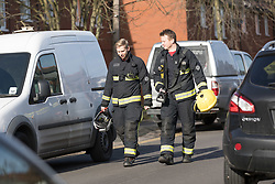 © Licensed to London News Pictures. 16/02/2018. London, UK. Firefighters outside Garenne Court in Warren Road, Waltham Forest. A murder investigation has been launched after a man was found dead suffering from multiple injuries yesterday, 15th February. A 38 year old woman and a 63 year old man were arrested on suspicion of murder in the early hours of this morning.  Photo credit: Vickie Flores/LNP