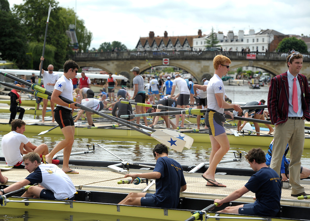 © Licensed to London News Pictures. 27/06/2012. Henley-on-Thames, UK Spectators watch rowing crews compete at the Henley Royal Regatta on June 26, 2012 in Henley-on-Thames, England. The 172-year-old rowing regatta is held 27th June- 1st July 2012. Photo credit : Stephen Simpson/LNP