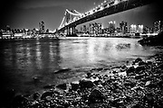 Bank of the East river by night at the Empire Fulton Ferry State Park with the Manhattan Bridge in sight, DUMBO, Brooklyn, New York, 2009.