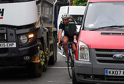 © London News Pictures. 25/08/2016. A cyclist choses to weave through traffic rather than use the cycle lane on Parliament Square in Westminster, London. Cyclists repeatedly ignore new cycle lanes installed around westminster in central London. Between the hours of 8am and 9am on Wednesday 24/08/2016, 266 (two hundred and sixty six) cyclists passed through the red light at one of the newly installed bike lanes and only 15 (fifteen) cyclists stopped.  The light system is designed to allow either vehicles or cyclists to pass at one time in order to make the junction safer for cyclists..... **VIDEO AVAILABLE** Photo credit: London News Pictures.