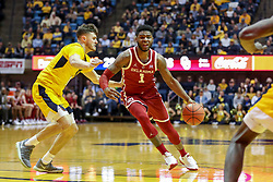 Feb 2, 2019; Morgantown, WV, USA; Oklahoma Sooners guard Rashard Odomes (1) drives down the lane guarded by West Virginia Mountaineers guard Chase Harler (14) during the first half at WVU Coliseum. Mandatory Credit: Ben Queen-USA TODAY Sports