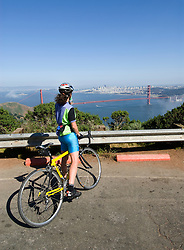 California, San Francisco:A bicyclist pauses in the Marin Headlands to view the Golden Gate Bridge..Photo #: 3-casanf79238.Photo © Lee Foster 2008
