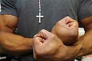 A prisoner flexes his muscles. HMP Wandsworth, London, United Kingdom