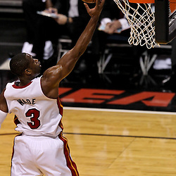 Jun 21, 2012; Miami, FL, USA; Miami Heat shooting guard Dwyane Wade (3) shoots a lay up against the Oklahoma City Thunder during the first quarter in game five in the 2012 NBA Finals at the American Airlines Arena. Mandatory Credit: Derick E. Hingle-US PRESSWIRE