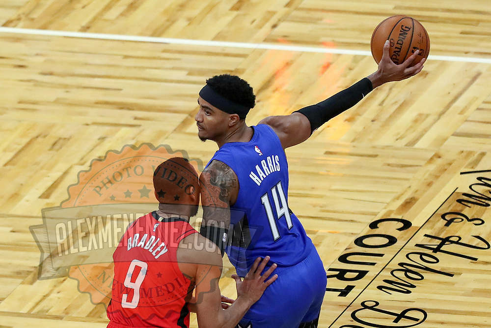 ORLANDO, FL - APRIL 18: Gary Harris #14 of the Orlando Magic holds the ball away from Avery Bradley #9 of the Houston Rockets during the first half at Amway Center on April 18, 2021 in Orlando, Florida. NOTE TO USER: User expressly acknowledges and agrees that, by downloading and or using this photograph, User is consenting to the terms and conditions of the Getty Images License Agreement. (Photo by Alex Menendez/Getty Images)*** Local Caption *** Gary Harris; Avery Bradley