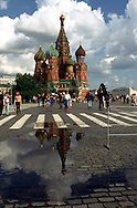 The spires of St. Basil's Cathedral are seen reflected in a puddle at Moscow's Red Square. June 2001.
