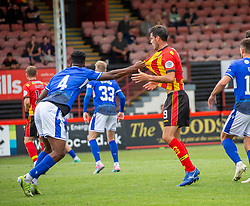 31JUL21 Queen of the South's Chima holds Partick Thistle's Brian Graham. Partick Thistle 3 v 2 Queen of the South. First Scottish Championship game of the season.