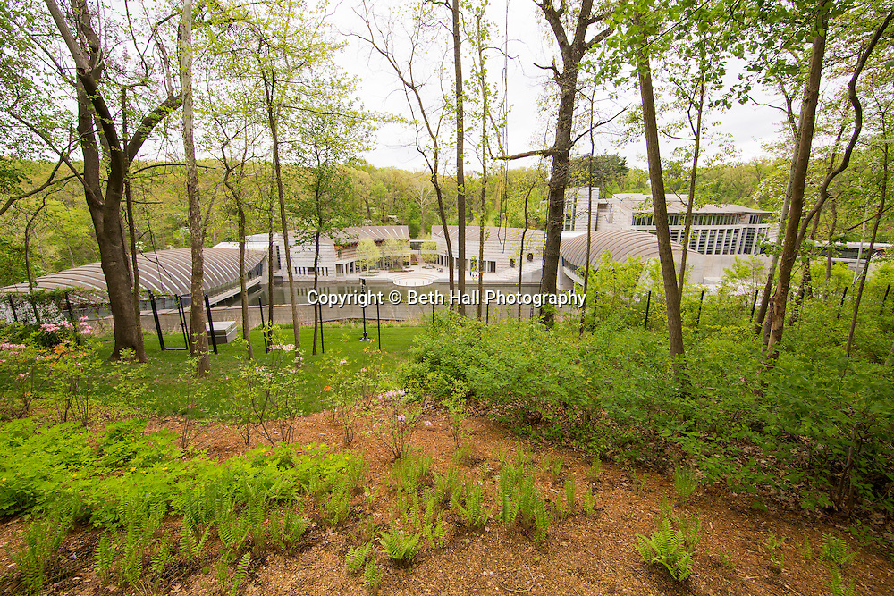 Crystal Bridges Museum of American Art as seen from the overlook on Thursday, April 23, 2015, in Bentonville, Ark.<br /> <br /> Photo by Beth Hall