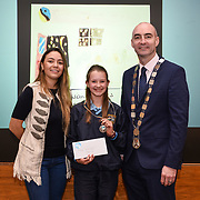 05/03/2019<br /> Pictured is 1st prize award winner Lara Orosz from Milford NS, along with Sara Montoya, co-op member of Fairtrade Colombia, and Cllr Daniel Butler, Mayor of the Metropolitan District of Limerick.<br /> <br /> Fairtrade worker Sara Montoya, from a Fairtrade Coffee Co-op in Colombia was the special guest in Limerick City and County Council chamber today at an event to coincide with Fairtrade Fortnight.<br />  <br /> Sara joined Fairtrade supporters from across Limerick and Ireland for the annual initiative, which features a programme of talks and community events aimed at promoting awareness of Fairtrade and Fairtrade-certified products.<br />  <br /> Speaking at the event in Dooradoyle, Sara outlined the success and benefits of the Fairtrade movement in Colombia and how important it is for people in the developed world think of Fairtrade products when shopping.<br />  <br /> This year's campaign 'Create Fairtrade' invites us all to use our imagination and create fairtrade in our lives.<br />  <br /> Young people from across Limerick city and county were also a focus of the event as they displayed their posters, which they created to help change the way people think about trade and the products on our shelves.<br /> Photo by Diarmuid Greene
