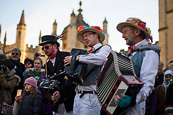 © London News Pictures. 01/05/2016. Oxford, UK. Musicians play to accompany Morris dancers outside Radcliffe Camera at Oxford University as part of celebrations for May Day, in the early hours of the morning. This year people were again prevented from jumping from the bridge in to the water due to serious injuries sustained at a previous years event . Photo credit: Ben Cawthra/LNP
