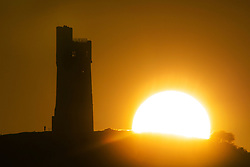 July 31, 2017 - Huddersfield, Yorkshire, UK - The sun rises this morning behind Victoria Tower on Castle Hill in Huddersfield. The tower was built in 1899 to celebrate 60 years old Queen Victoria's reign & sit's 1000ft above sea level. (Credit Image: © Andrew Mccaren/London News Pictures via ZUMA Wire)